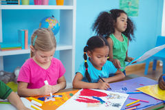 Happy kids all drawing pictures Stock Images