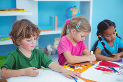 Happy kids all drawing pictures Royalty Free Stock Photo