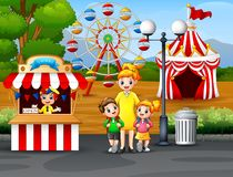 Free Happy Kids And Their Parent Having Fun In An Amusement Park Stock Photos - 141053623
