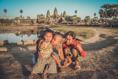 Happy kids at Angkor Wat. Happy young kids playing in front of Angkor Wat temple in Cambodia Stock Images