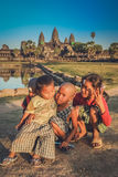 Happy kids at Angkor Wat. Happy young kids playing in front of Angkor Wat temple in Cambodia Royalty Free Stock Photography