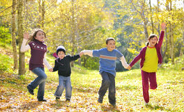 Happy kids and autumn leaves Royalty Free Stock Photo