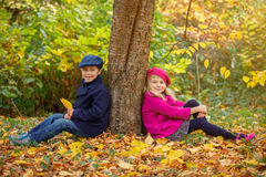 Happy Kids in Autumn Park Stock Photo