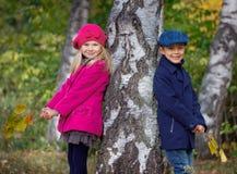 Happy Kids in Autumn Park. Happy Kids walking in beauty Autumn Park Stock Photos