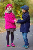 Happy Kids in Autumn Park. Happy Kids walking in beauty Autumn Park Stock Photo