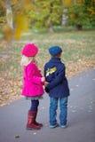 Happy Kids in Autumn Park. Happy Kids walking in beauty Autumn Park Stock Photography