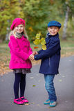 Happy Kids in Autumn Park. Happy Kids walking in beauty Autumn Park Stock Image