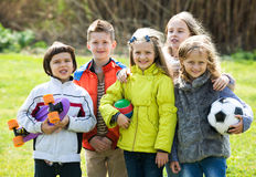 Happy kids with ball having fun outdoors Stock Images