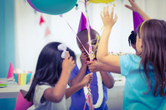 Happy kids with balloons. At the birthday party Stock Images
