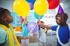 Happy kids with balloons. At the birthday party Stock Photography