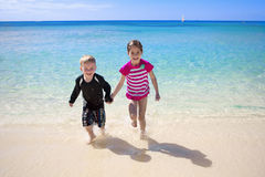 Happy Kids on a Beach Vacation Stock Photography