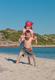 Happy kids on the beach. The vertical picture of the kids making fun on the beach stock images