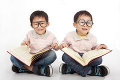 Happy kids with big book Royalty Free Stock Photos
