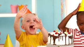 Happy kids at a birthday party. In slow motion stock video