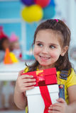 Happy kids at a birthday party Stock Image