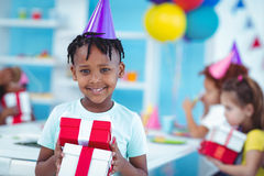 Happy kids at a birthday party Stock Images
