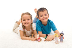 Happy kids boy and girl playing on the floor Royalty Free Stock Photo