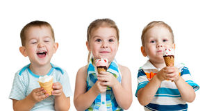 Happy kids boys and girl eating ice cream isolated. Happy children boys and girl eating ice cream in studio isolated Stock Photography