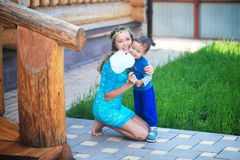 Happy kids, brothers and sister, laughing teenager boy Stock Photos