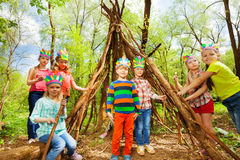 Happy kids building Injun's wigwam in the forest Royalty Free Stock Photography