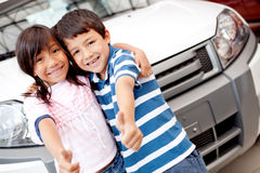 Happy kids buying a car Royalty Free Stock Image