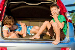 Happy kids in car, family trip, summer vacation travel. Three happy kids in car, family trip, summer vacation travel Royalty Free Stock Photography