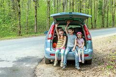 Happy kids in car, family trip, summer vacation travel. Three happy kids in car, family trip, summer vacation travel Stock Images