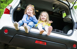 Happy kids in the car Stock Photos