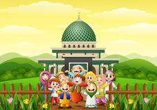 Happy kids cartoon celebrate for eid mubarak in the park with mosque Royalty Free Stock Images