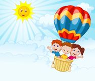 Happy kids cartoon riding a hot air balloon Royalty Free Stock Photo