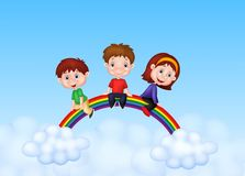 Happy kids cartoon sitting on rainbow Royalty Free Stock Images