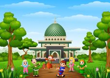 Happy kids celebrate for eid mubarak with mosque background Royalty Free Stock Images
