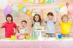 Happy kids celebrating birthday holiday. Happy children boys and girls celebrating birthday holiday royalty free stock image