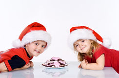 Happy kids with christmas cookies Royalty Free Stock Photos