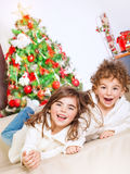 Happy kids in Christmas eve Royalty Free Stock Photography