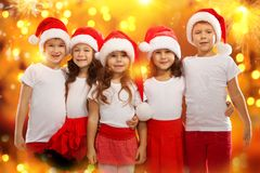 Happy kids in Christmas hat with colorful lights Royalty Free Stock Photo