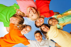 Happy kids close in circle on sky background