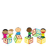 Happy kids and colorful blocks Stock Image