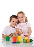 Happy Kids Coloring Easter Eggs Stock Photography