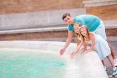 Happy kids and dad enjoy their european vacation in Italy Stock Photo
