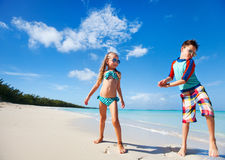 Happy kids dancing at beach Stock Images