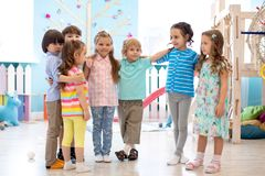 Happy kids at daycare stock photography