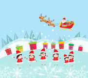 Happy Kids Decorating santa claus With gifts Stock Images