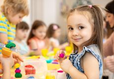 Happy kids doing arts and crafts in day care centre. Happy kids doing arts and crafts in daycare centre royalty free stock photo