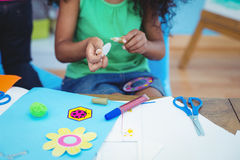 Happy kids doing arts and crafts together. At their desk Royalty Free Stock Photos