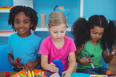 Happy kids doing arts and crafts together stock photo