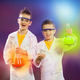 Happy kids doing science experiments in the laboratory. royalty free stock photos