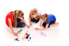 Happy kids drawing on white. Team work, creativity concept royalty free stock image