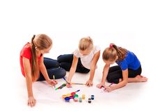Happy kids drawing on white. Team work, creativity concept stock photography