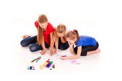 Happy kids drawing  on white Royalty Free Stock Photography